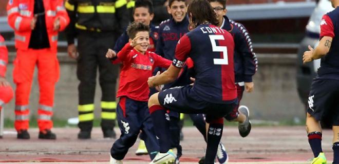 Daniele Conti abbraccio figlio